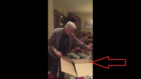 Dad opens Christmas gift to find the best surprise ever!