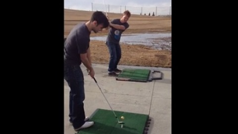 Two Friends Pull Off Incredible Golf Trick Shot