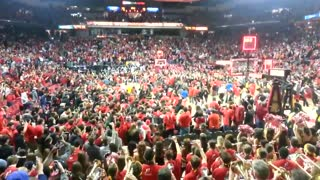 Fans Storm Court After NCAA Basketball Upset - Video