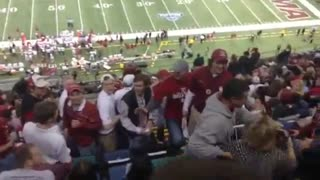 Crazy Woman Launches Herself In Fight at Sugar Bowl - Video