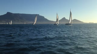 Smiling girl with lovely Table Mountain as a backdrop filmed from Table Bay - Video