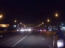 Elderly Woman Crosses Highway During Night - Video