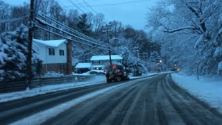 Snow Plow Drives on Wrong Side of Road - Video