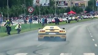 Super Car Loses Control, Crashes Towards Crowd