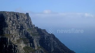 Snow falls on Table Mountain, Cape Town - Video