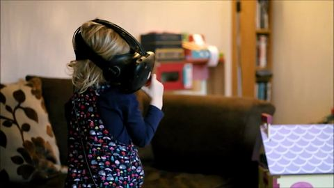 Little girl explores VR dollhouse