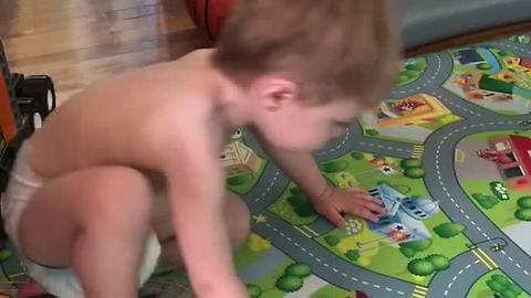 Toddler Tries To Keep Up With His Dad's Workout Routine