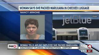 Woman tells airport employee she has marijuana in her checked bag - Video