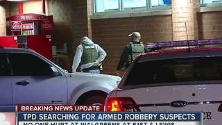 Suspects loose after robbing Walgreens overnight - Video