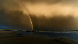 Timelapse Shows Double Rainbow as Sunset Storm Passes Over Ocean Grove - Video