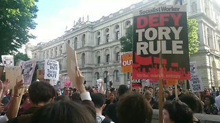 Protesters Call for Theresa May's Resignation Outside Downing Street - Video