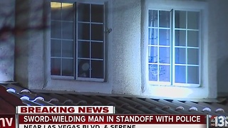 Man armed with samurai sword barricades himself in home - Video