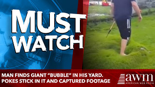 "Man Finds Giant ""Bubble"" In His Yard. Pokes Stick In It And Captured Footage - Video"
