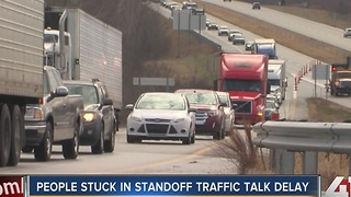 People stuck in standoff traffic - Video