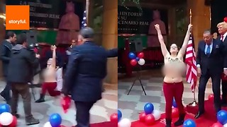 Protester Bares Breasts at Wax Trump Unveiling - Video