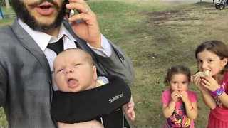 Funny Dad Does Jason Bourne Impression With Baby Bjorn Carrier On - Video