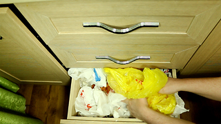 How to make proper use of extra grocery bags - Video