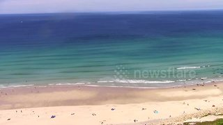 Tourists hit the beaches as Cornwall heats up - Video