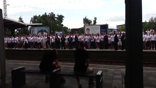 Football fans put on insane show while waiting on train platform - Video