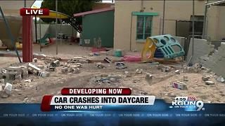 Car crashes into wall of daycare playground, no injuries - Video