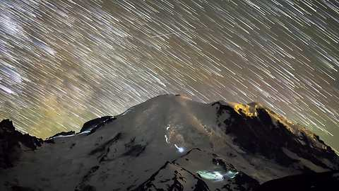 Time lapse captures hikers traversing up Mt. Rainier under Milky Way Galaxy