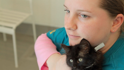 Young, autistic woman finds the confidence to speak through love of black cats