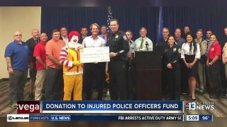 McDonald's donates money to police - Video