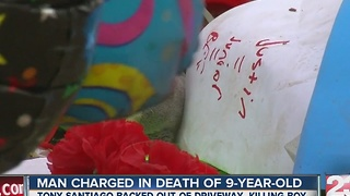 Vigil in place after man charged with death of nine-year-old boy - Video