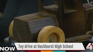 Rockhurst HS students build toy trucks for children in need for the holidays - Video