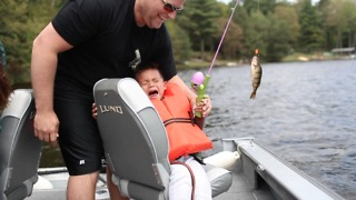 Toddler breaks into tears after reeling in fish