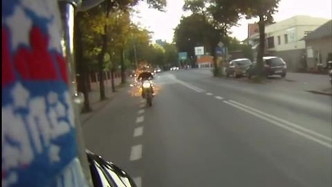 Motorcycle exhaust on fire spits out flames