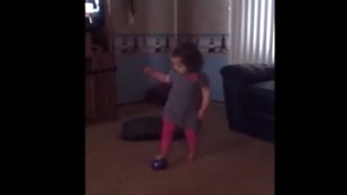 Toddler proves her toughness after wiping out - Video