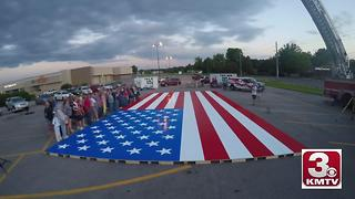 Omaha sets a Guinness world record for the largest American flag made out of interlocking bricks - Video