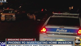 Police investigating home invasion in Phoenix - Video