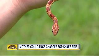 Possible charge after mother let snake bite baby - Video