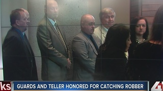 Police honor guards, bank teller for catching robber - Video