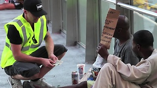 Disguised magician creates money for the homeless