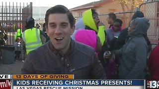 Children receive toys at 13 Days of Giving toy giveaway - Video