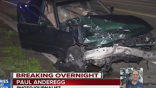 Police searching for people after a car they were chasing crashed into an innocent motorist - Video