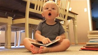 "Funny boy Repeatedly Says ""oh no"" While Reading Book - Video"