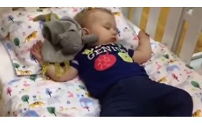 Dad Puts Baby Down for a Nap In Department Store Show Room - Video