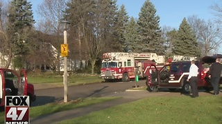 Two escape from house fire in East Lansing - Video