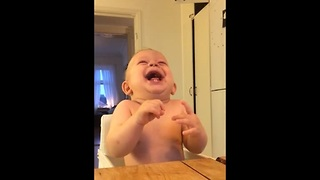 Baby laughing hysterically at coconut - Video