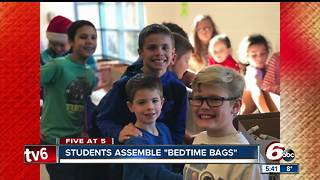 Elementary school students put together bags of supplies for homeless children