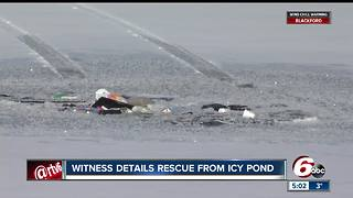 Woman pulled from vehicle submerged in frozen Indianapolis pond - Video