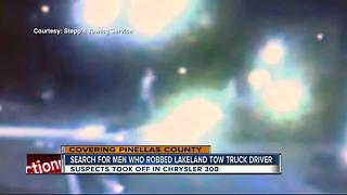 Lakeland tow truck driver robbed at gunpoint - Video