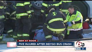 Four people injured in crash between an IndyGo bus and a Chrysler Sebring - Video