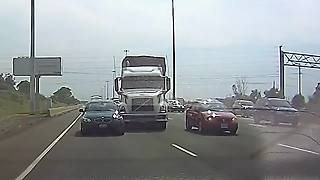 Truck driver swerves to avoid car, hits another vehicle - Video