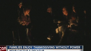 Families celebrate Thanksgiving evening in the dark after outage - Video