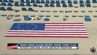 Terry cloth American flag tribute lines beach in front of TradeWinds Island Resorts - Video